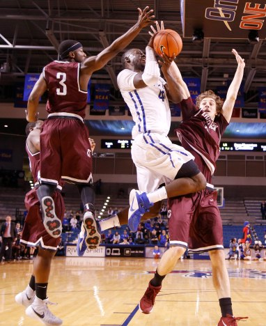 TU No.3 Shaquille Harrison attempts a shot after being fouled by Little Rock No.0 Roger Woods during the men's basketball game at the TU Reynolds Center in Tulsa, Okla., taken on November 28, 2015. JAMES GIBBARD/Tulsa World